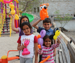 Happy kids in Turkey -- Can we have a world with more balloons and less violence?
