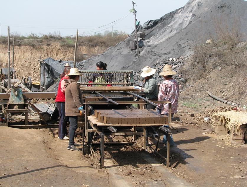"The brick ""factory"" conveyor belt in Pangliu village"