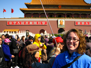 Posing in front of Chairman Mao's portrait