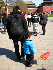 Father and daughter entering Forbidden City
