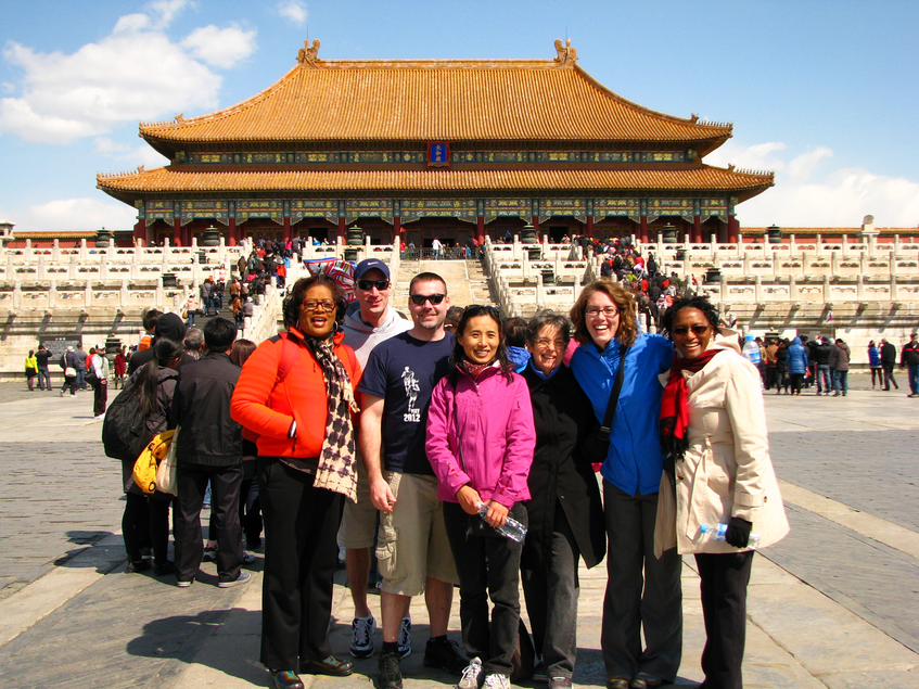 Massachusetts school leaders in front of one of the 990 buildings of the Imperial City