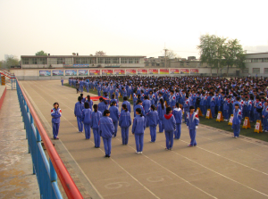 Students gather during flag-raising ceremony