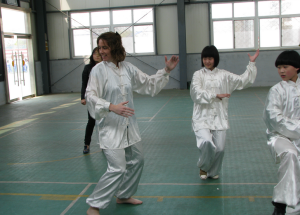 Learning tai chi alongside students