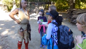 Students talking to a real Native American man at Plimoth Plantation