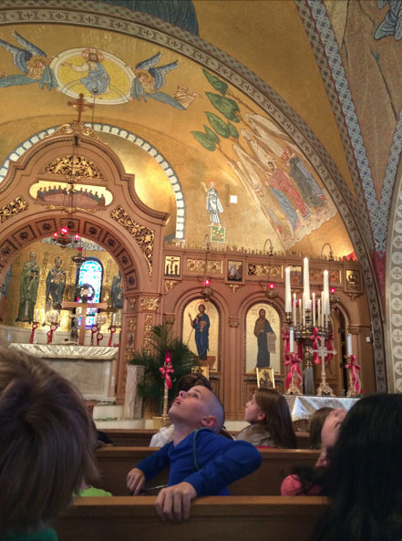 A student marvels at the mosaics of the Greek Orthodox Church