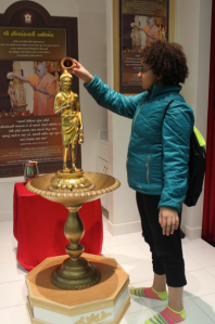 Exploring a statue of a Hindu God