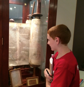Checking out a Torah rescued after WWII.