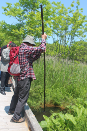 Professor Kanda with a long pole