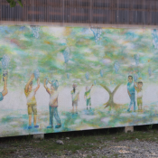 A mural at the school shows what the students are working on with the grapes.