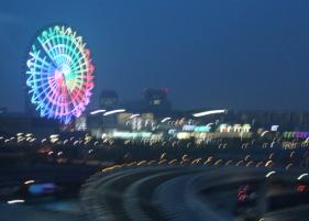Ferris wheel and highway