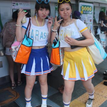 Some teenagers showing off their idol earrings in the Harajuku Neighborhood
