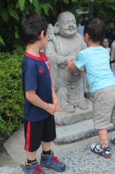 Kids Playing on Buddha Sculpture