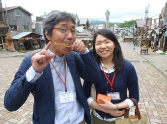 Yasumi San and Yuriko enjoying the Ainu Village (Yasumi San is better at piano than this traditional instrument)