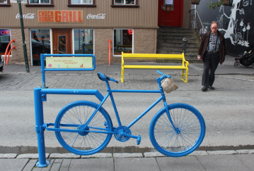 The Chuck Norris Grill looks great behind this awesome bicycle gate