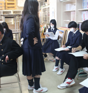 Students in art class, sketching one of their classmates