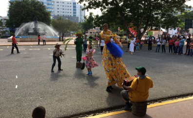 Some sort of performance with stilts, cool costumes, and music