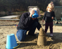 Helping my niece make a sand sculpture